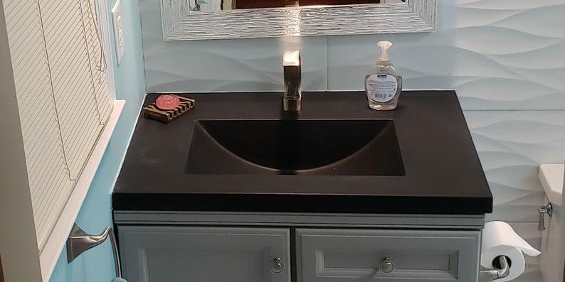 dark gray concrete barrel large basin in bathroom