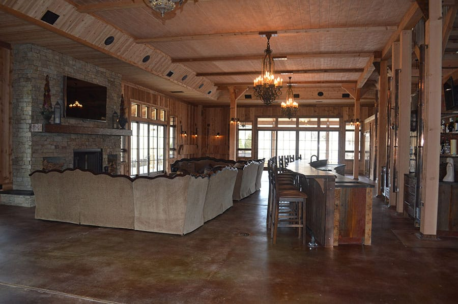 Large lodge with concrete flooring and two level concrete bar