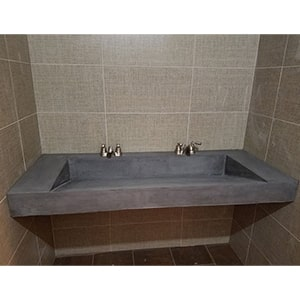 concrete double ramp faucet in commercial space