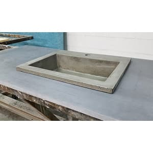 concrete vessel drop in sink in the shop