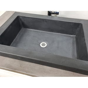 gray concrete vessel sink