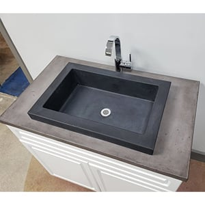concrete vessel sink installed in single cabinet