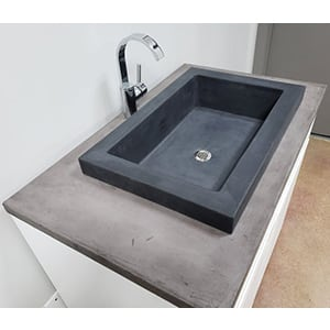 gray concrete vessel sink with fancy faucet