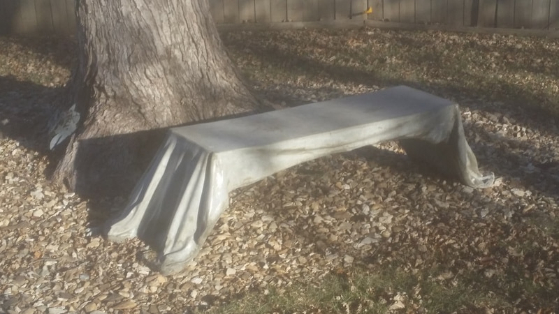 decorative gray concrete bench with the appearance of draped cloth