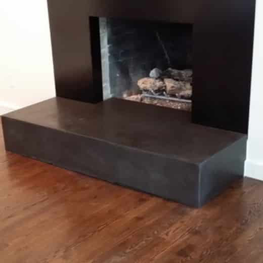 installed concrete fireplace surround